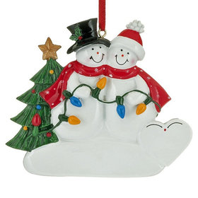 Snowman Couple Holding a String of Lights